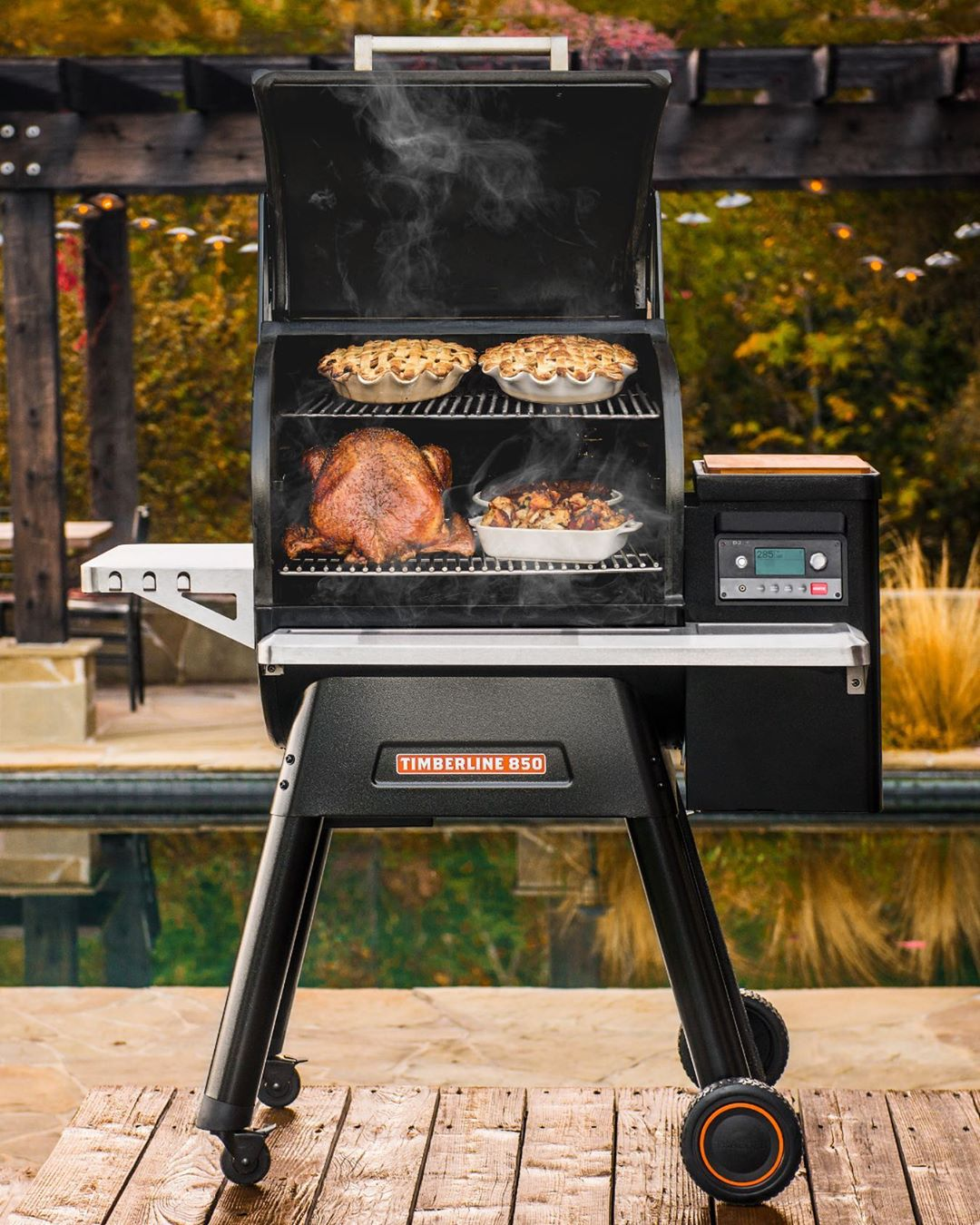 traeger grills in front of a picture of a barn